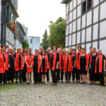 2017 Joyful Voices, Chor steht in der Eisengasse,